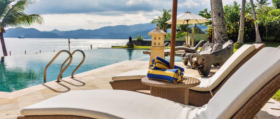 Oceanside pool and patio with mountain views at Citakara Sari Estate