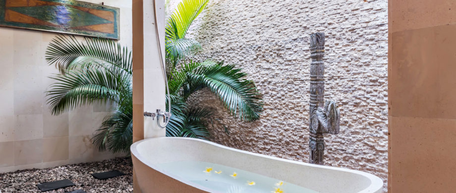 Private outdoor tub with palms and flowers in Villa Saraswati at Citakara Sari Estate