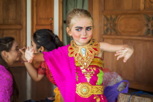 A family immersing in Balinese culture and dance at Citakara Sari Estate in Bali