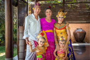 A family enjoying Balinese costumes and art during a Citakara Sari Estate vacation