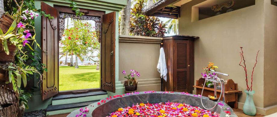 Flower-filled spa tub with an ocean view for your Bali vacation at Villa Joglo at Citakara Sari Estate