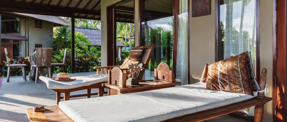 Patio lounge chairs with an ocean view at Villa Joglo at Citakara Sari Estate