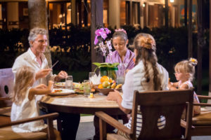 A family enjoying Balinese cuisine on vacation in Bali at Citakara Sari Estate