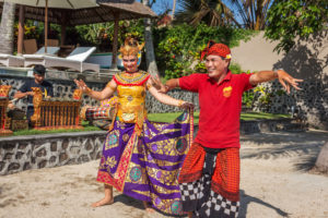 A private family Balinese dance lesson while wearing Balinese costumes at Citakara Sari Estate